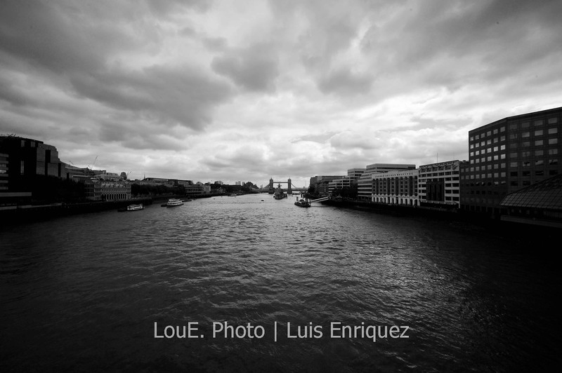 August 14, 2009<br /> <br /> London Bridge<br /> London, UK<br /> <br /> The low clouds definitely accented the great black and white scenics along the Thames.  Here is a shot of Tower Bridge from London Bridge.<br /> I love all of the architecture along the embankment and walked for miles alongside the Thames for maximum absorption.