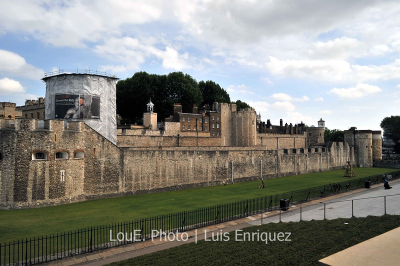 August 14, 2009<br /> <br /> Tower of London<br /> London, UK<br /> <br /> Here is a shot from the side of this historic fortress and scheduled monument.  The admission was a little expensive and the crowds were ridiculous at times but very interesting as I thought of the debauchery, torturous activities, and the excessiveness and sumptuousnes of royal life.  I did miss the crown jewels as the line up stretched the length of the outer wall.  Lots to see anyway and I did come away with some great shots.