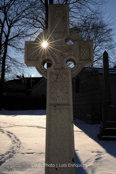 January 3, 2009<br /> <br /> St James Cemetery.<br /> Interesting cemetery in downtown Toronto as I waited for the sun to dip to a respectable level of harshness.  My hands were feeling numb from the cold and it was affecting my creativity although I thought this was an interesting shot with the sun.