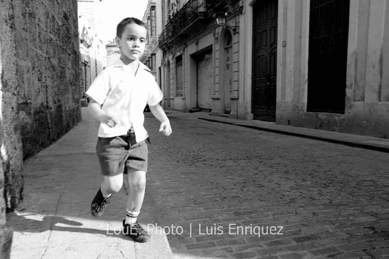 April 14, 2009<br /> <br /> More kids running around Old Havana as school has finished for the day.  I was lucky enough to photograph this little guy as I turned around and snapped a blind shot from my hip as I heard his little uniform shoes clap the pavement behind me.