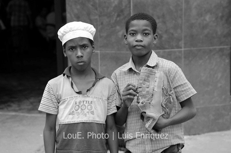 April 19, 2009<br /> <br /> Your typical cuban boys wandering the streets of Old Havana, eating ice cream and playing baseball in the tightest of spaces.  These guys posed reluctantly but were rewarded with a CUC.  I really like this portrait as their faces, clothes, and reactions tells the story of Cuba for me.