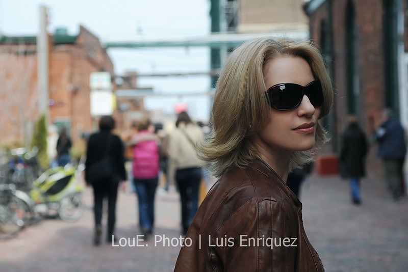 March 28, 2009<br /> <br /> Strolling through the Distillery District on this balmy Saturday afternoon and snapped this beautiful shot of Colette.  I was about ten feet behind her usual fast pace walking and told her on my que to turn and look at me quickly.  <br /> I test myself and my camera on occasion with these exercises and today was perfect on the first and only attempt.