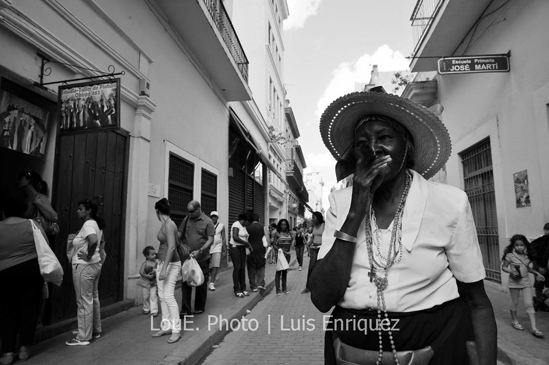 April 15, 2009<br /> <br /> Walking down Obispo Street in Old Havana and came across the classic cigar smoking local far from her tourist spot as I captured her in mid puff.