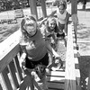 Jennifer Lynch, Stephanie King and Kelly King help some children across the bridge on the Asbury House playground.  Lester Phipps, Jr.