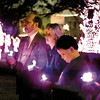 Dr. James Sawyer, Nancy Davis and David Sawyer all of Longview holds candles Sunday night at the Candle Light Ceremony for World Aids Day at the Gregg County Courthouse. Dr. Sawyer has been treating HIV for the past ten years locally. By Kevin Green