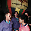 Baloon passenger Tonya Solis, right, talks her game plan over with her pilot, Chuck Rohr-sponsored by Pegues-Hurst Ford, for the Media Day race whiule at the race kick-off party at Maude Cobb Center Thursday evening. Chris Matula photo.