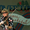Barbara Lamb fiddles for the crowd Saturday at the Overton Blugrass Festival. Chris Matula photo.