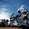 BMX riders negotiate the first jumpTuesday evening at the ET track in Longview near the Stroh's brewery. The sport has been around awhile but surges in popularity every few years. Chris Matula photo.