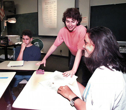 Bridgette Hewitt a math teacher at Longview High School helps students with their algebra during the algebra academy class at Longview High School Thursday morning. By Kevin