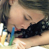 Kathryn Lang, 10, concentrates extra hard on her coloring during Summer Art Week at the Longview Art Museum tuesday. Chris Matula photo.