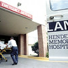 Henderson EMT's Stoney Robinson and Dustin Williams deliver a patient to the Henderson Memorial Hospital emergency room.   Lester Phipps, Jr.