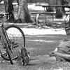 Timothy Addington of Longview takes a break to cool off under a tree at Teague Park.  Addington enjoyed his day off from his job at the Fisherman's Market to ride his bicycle around Longview.   Lester Phipps, Jr.