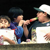 Edgar Vega, left (8), MArtin Aranda, 7, and Hector Vega, 10, enjoy popcicles preceeded by a hot dog lunch during Pine Tree Primary's bilingual fair Saturday. Chris Matula photo.