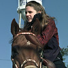 Jessica Young, 15, watches the rest of the Hallsville Western Days parade from atop her horse after participating as flag bearer at the start of the procession Saturday morning. Chris Matula photo.