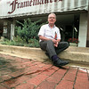 Jim Isbell, owner of The Framemakers, a store on East Tyler Street in Longview, is one of the many downtown merchants who don't want the city to tear up the brick streets downtown.  Lester Phipps, Jr.