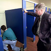 Elder Co-operative Alternative School Principal Dwain Reynolds supervises a student as he cleans a commode as part of his community service work.  Lester Phipps, Jr.