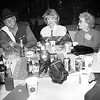 Tommy Williams, Vickie Beatty and Tillie Iloff all of Longview talk at the Boot Scoot 96. By Kevin Green