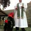 "Father Stephen Butts, pastor of St. Paul's Episcopal Church in Kilgore stands with his cocker spaniel ""Bo"" the Bishop before beginning the Blessing of the Animals in observance of St. Francis Day.  Church members brought their dogs, cats and even fish to be blessed then competed in a pet parade.  Lester Phipps, Jr."