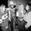 Jamie Dippold, Jamie and Ann Duke and Jennifer McConnell all of Longview talk during the Boot Scoot. By Kevin Green