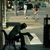 B.J. Fowler takes a break to read the newspaper and drink a cup of coffee on Main Street in Gladewater.  Matula photo.