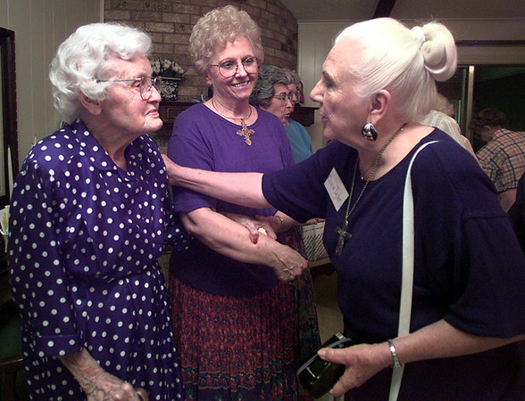 Feigh Vaughn, left, gets happy birthday greeting from Euneva Taylor, right, as Dorothy Butterfield, center, looks on at Feigh's 96th birthday recently. Kevin Green