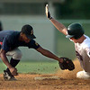 Longview shortstop Garland Hawkins just misses the tag on Texarkana's Quintin Fincher as he steals second during the winner's bracket of the American Legion state tournament at Gibson Field Friday. Hawkins managed to get him out at third on the next play. Matula photo.
