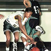 Longview's #52 attempts the steal on a tripped-up #22 Dallas-Adams player as #45 looks on during the 4th period Thursday night at Lobo Coliseum. Matula photo