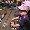 Spring Hill Elementary student Michael Horn gets a chance to operate  the controls to Ron Buckner's model trains Friday afternoon during Hobby day. Adults visited the school bring along their hobbies to share with the children. by darlene
