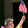 Brad Hall, the three year old son of Charles and Susan Hall, looks up at his flag as he holds it up during a the Wee Learn Center July the 4th parade, Thursday morning at  First Baptist Church in Longview. Kevin Green