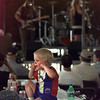 "If it's too loud, you're too young! Cameron Morris, 3, plugs his ears as ""Cat Daddy"" takes the stage at AlleyFest Saturday. Matula photo."
