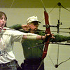 Longviewite Tammy Hobbs and Fred Leggett, from Midland, practice knocking arrows Friday evening at Maude Cobb Activity Center in preparation for the big tournament this weekend. Matula photo.