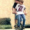 Eric Weeks the 13 year old son of Chris and Pam Crump of White Oak gives Jerry Whittington the 13 year old son of Don and Cindy Whittington, a ride Tuesday afternoon after school in White Oak. Kevin Green