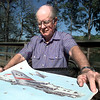 Former B-17 belly turret gunner Jack Robinson looks over a lithograph of the plane that he flew in during WWII.  Matula photo.