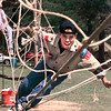 Date:   4/4/98---Steven Fox,12, with Boy Scout Troup 193 of Gladewater, looses his balance but manages to hold on to the monkey bridge Saturday morning just east of Longview, at the Boy Scout Camporee. Kevin green