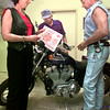 Gaylene Freeman, left, honarary chair, and Jim Swanson, right, visit with Don Rice, center, of Longview, after selling him a raffle ticket for a chance at a Harley Sportster, sponsored by the Harley Shop of Longview, Satday afternoon at the Harley Shop in Longview, proceeds benefit the Cattle Baron's Ball fundraiser for the American Cancer Society. Kevin rgeen