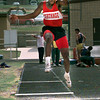 Date:   4/15/98--Damien Williams from Carthage runs the long jump during the track meet Wednesday morning in Gilmer. Kevin green