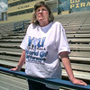 Date:   4/17/98-- Amy Hill, coordinator of Because I Care, stands in Pine Tree's Pirate Stadium, Friday afternoon looking over the track where a walkathon was held in 1990 to raise funds for two leukemia patients who needed bone-marrow transplants. Kevin green