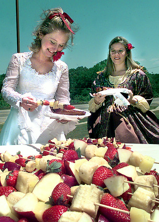 Date:   4/23/98---Mitzi Stoute, left, and Kristen Wootten, right, both seniors at New Diana High School, go through the serving line Thursday afternoon during the 434th birthday celebration for William Shakespeare, which included students dressed up and they had a Renaissance luncheon. Kevin green