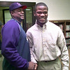 Steve Craver, left, shakes hands with his son Keyvo, after signing a letter with Nebraska Wednesday morning at Harelton High School. Kevin green