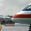 A handler prepares to instruct an American Eagle flight onto the taxiway as a Sunpoint flight rolls down the runway in the background. Matula photo.