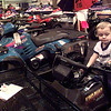 Mason Bobbitt,3, of Lake Tyler, plays on a display of 4x4 atv vehicle at the Boat Show at Maude Cobb in Longview. Kevin green
