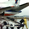 An American Eagle baggage handler loads a flight at Gregg Co. Airport. Matula photo.