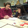 Anne Benbow, left, tutors Stacey Flores,8, a 3rd grader at Valley View Elementary. Kevin green