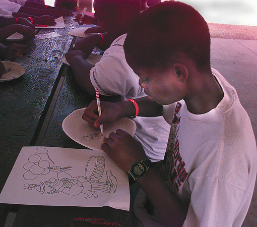 Date:   7/1/98---Rodney Moore, son of Billy and Doretha Moore of Longview, concentrates on his drawing at the Longview Parks and Recreation camp at Broughton Park Wednesday morning in Longview.  Jessica Williamson