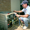 Date:   7/20/98----Rick Ellis, a service technician with Ben Maines of Longview, chackes the freon in a AC unit after replacing the blower motor in the 3000 blk. of Bill Owens Parkway Monday afternoon in Longview. Kevin green