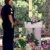 Date:   7/10/98---LPD Sgt. James Johnson spends a quiet a moment after the funeral for Baby Jane Friday afternoon Grace Hill Cementery in Longview. Kevin green