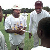 Date:   6/18/98---Larry Centers, left, and Victor Bailey, right, go over plays during the HYPE football camp at LHS Thursday afternoon in Longview. Kevin green