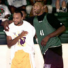 Date:   6/20/98---Bobby Taylor, left, and Michael McDonald, right, horse around during the HYPE basketball game at LHS. Kevin green