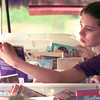 Date:   6/18/98---Ashley Muckleroy,14, looks through books on the GIlmer ISd bookmobileat the old Kelsey School outside of Gilmer. Kevin green