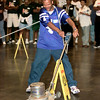 Date:   6/10/98---Jimmie Reid, with Tyler ISD trys his hand with the floor buffer duirng the janitor olympics Wednesday afternoon at Maude Cobb Activity Center in Longview. Kevin green